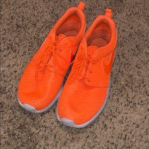 Neon orange nike roshes
